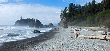 pebles: People stroling along sea stacks on Ruby Beach. Stock Photo