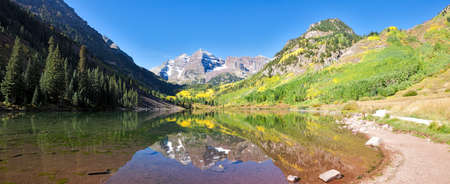 Snow covered Maroon Bells in autumn. photo