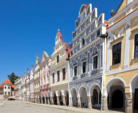 Facade of city houses with arcade on square in Telc, Czech Republic.