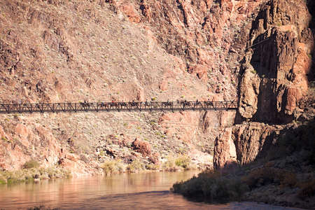 desert ecosystem: Kaibab Bridge with tourists riding mules in Grand Canyon. Stock Photo