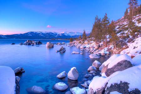Boulders in Lake Tahoe at sunset  photo