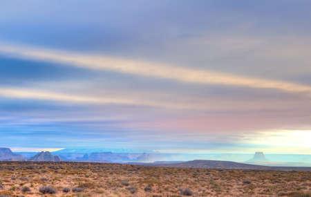 Sun shining on Lone Rock under heavy clouds Stok Fotoğraf