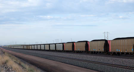 A mile long line of train cars loaded with coal