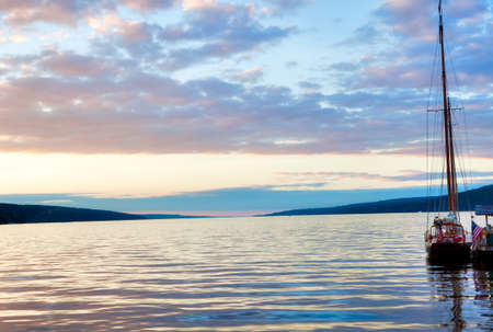 Shooner at sunset on tranquille lake Seneca  Stock Photo