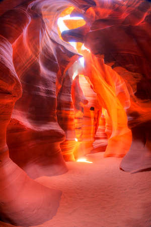 Sunbeam piercing through sandstone at high noon in Antelope Canyon.