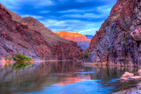 rafting: Reflection in Colorado River of Butte catching days last rays, in Grand Canyon.