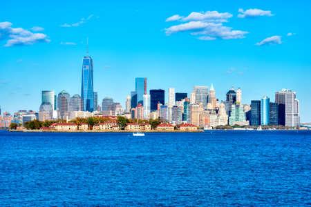 ellis: Manhattan skyline with Ellis Island in foreground