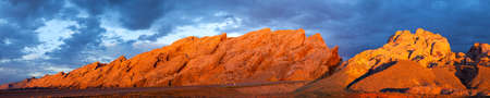 swell: I-70 cut through San Rafael Swell at sunrise, with storm clouds above  Stock Photo