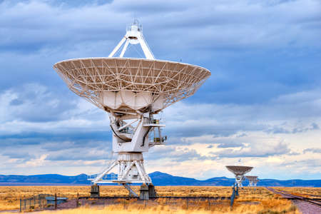 Radio antenna dishes of the Very Large Array radio telescope in New Mexico, searching for yesterday  photo