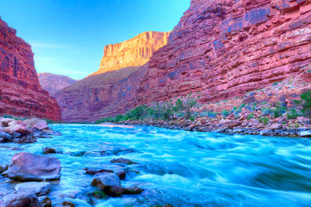 rafting: Reflection in Colorado River of Butte catching days last rays, in Grand Canyon  Stock Photo