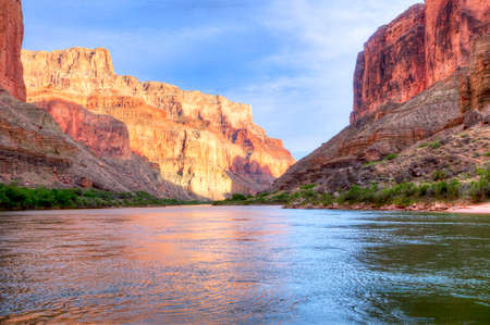 Reflection in Colorado River of Butte catching days last rays, in Grand Canyon  Stock Photo