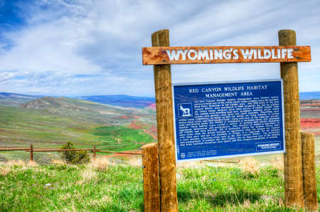 A sign explains Wyomings nature and wildlife at a rest area.