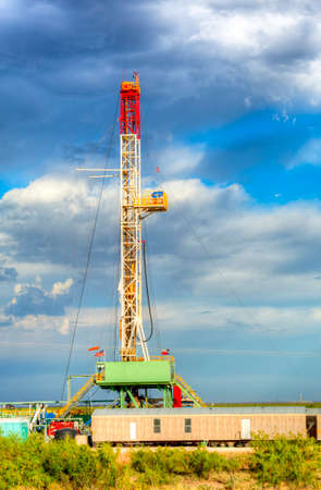 Land oil drilling rig on oilfield in Texas. photo