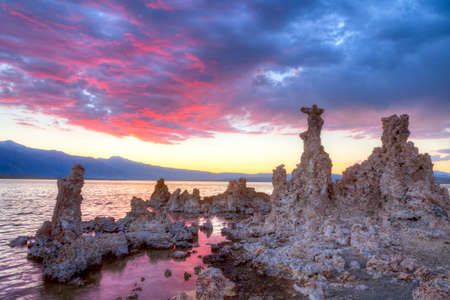 inyo national forest: Blood red sky over Tufas in Mono Lake. Stock Photo