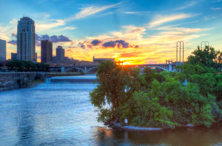 mississippi river: Sun is setting over Mississippi River, in Minneapolis. Stock Photo