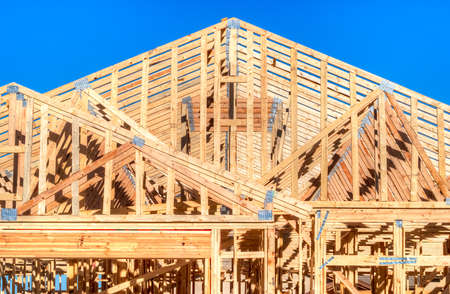 house under construction: Wooden frame of an residential house under construction