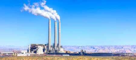 Coal power plant with smoke stacks.