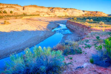 paria: Paria River flowing through the base of the Vermillion Cliffs in desert landscape of Arizona