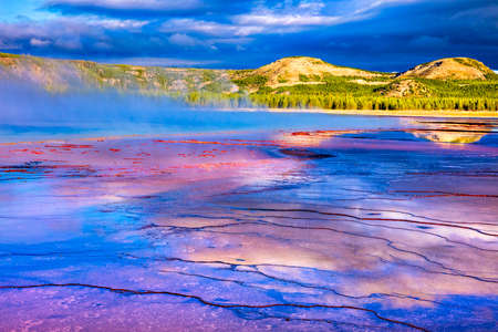 Sunrise at Grand Prismatic Spring in Yellowstone National Park. Stock Photo