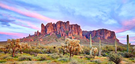 Panorama of Superstition Mountains at sunset. Фото со стока