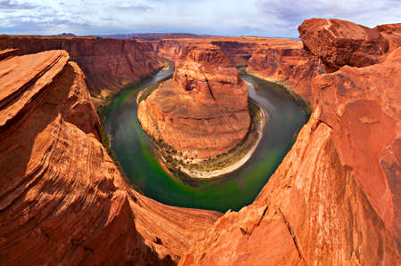 Tranquille Colorado River flowing through Horseshoe Bend, near Page, Arizona.