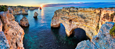 Sunrise at Heart Arch on beautiful coast of Algarve at sunrise, Portugal.