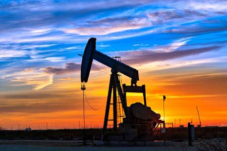 Dawn over petroleum pump. Stock Photo