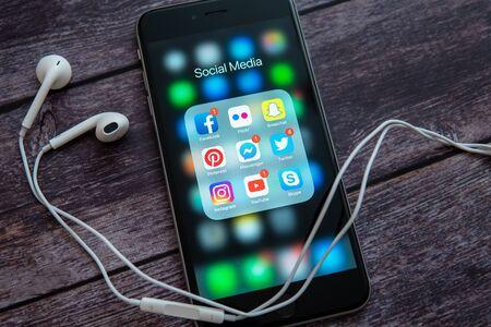 New York / USA - 12/04/2019: Black Apple iPhone with icons of social media: instagram, youtube, facebook, pinterest, twitter, snapchat application on screen. Social media icons. Marketing concept. Redakční