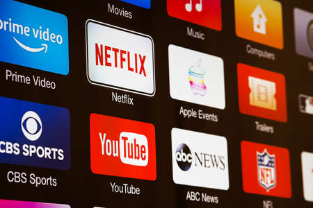 Miami / USA - March 17, 2020: Smart TV with icons of video streaming services and apps: YouTube, ABC News, Tastemade, UFC, NFL, Crunchyroll, Flickr and Red Bull TV. News media on the screen