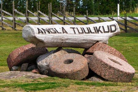 Saaremaa / Estonia - July 19, 2020: Angla Tuulikud on the Saaremaa Island. Historical composition of the natural wooden mills