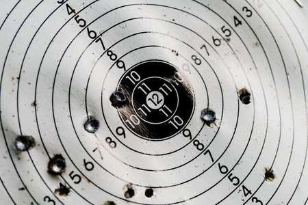 Used shooting target with traces of hit bullets