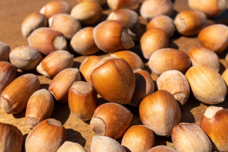 Natural organic hazelnuts on the wood table background