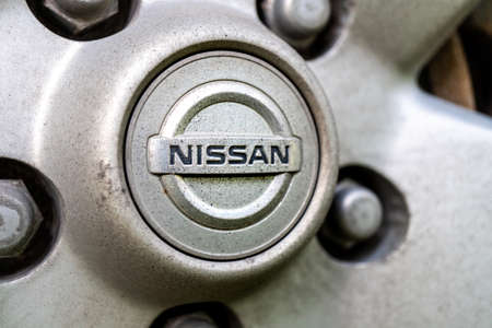 Tallinn / Estonia - August 28, 2020: Close up of Nissan logo on the old SUV wheel. Nissan is a brand of International Renault – Nissan – Mitsubishi Alliance Éditoriale