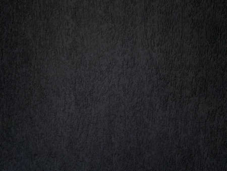 Black concrete wall is a decorative or textured surface. Can be used as a background or for design purposes