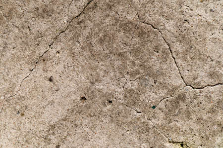 A very old concrete wall is a decorative or textured surface. Can be used as a background or for design purposes