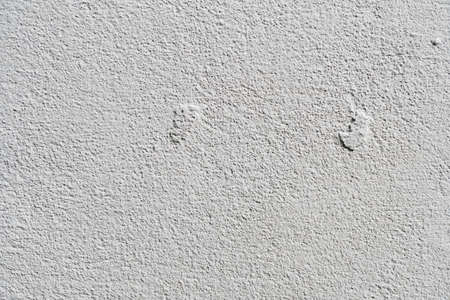 White or gray concrete wall is a decorative or textured surface. Can be used as a background or for design purposes