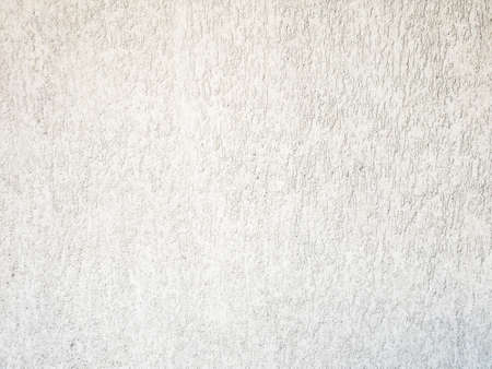 White concrete wall is a decorative or textured surface. Can be used as a background or for design purposes
