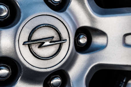 Tallinn / Estonia - Mai 2, 2021: Close up of Opel dirty emblem on the old wheel disk. Economy class car accessories and design elements. Close-up image. Sajtókép