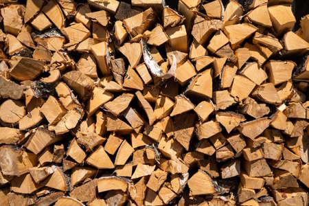 Wooden trunks timber harvesting. Log trunks pile, the logging timber forest wood industry.