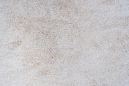 White and gray concrete wall is a decorative or textured surface. Can be used as a background or for design purposes
