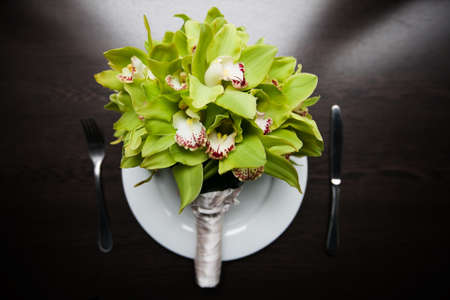 Wedding bridal bouquet on the plate