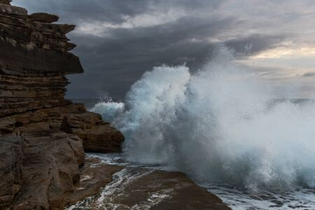 Big waves crashing against the cliffs at Clovelly NSW Australia