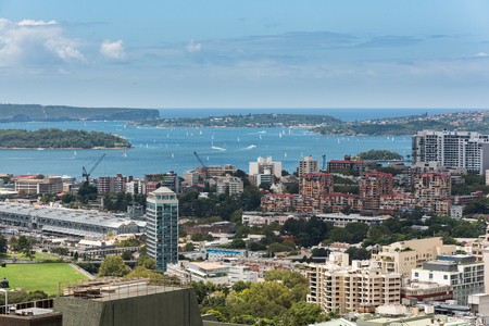 house top: Sydney harbor with ships and yachts and adjacent bulidings from height