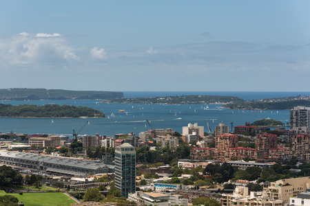 adjacent: Sydney harbor with ships and yachts and adjacent bulidings from height