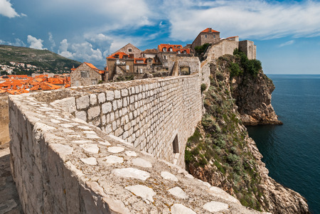 impregnable: Dubrovnik, Croatia view from city walls overlooking walls and sea with cliffs during the day Editorial