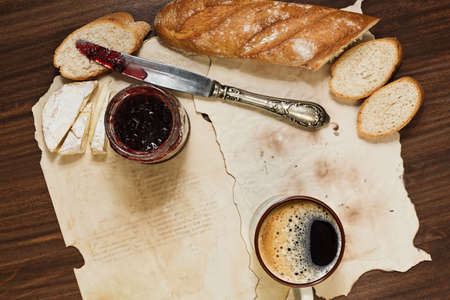 rustic: Hipster styled breakfast of espresso coffee, baguette bread, french cheese and cranberry jam Stock Photo