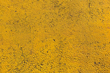 Rude concrete textured background in yellow color