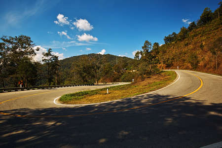 Dangerous sharp curve on a mountain highway road