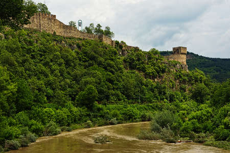 travel features: Ancient fortress ruins stands over the river on the hill Stock Photo
