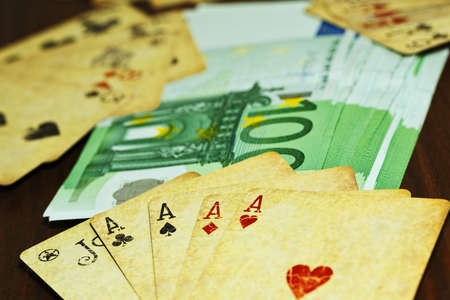 Vintage playing cards with wonderful poker combinations and euro money on the table